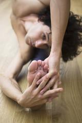 Man yoga teacher in gym