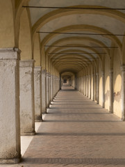 capuchin's loggia in Comacchio in the province of Ferrara, Italy. Prospective view of the long portico in masonry