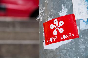 Sticker of a Hong Kong flag attached to a lamppost in Sheung Wan, Hong Kong