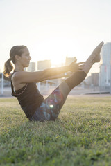 A Young woman doing yoga exercise outdoor