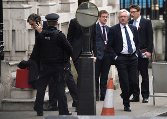 Britain's Secretary of State for Exiting the European Union David Davis and Chief Whip in the House of Commons Julian Smith, make their way to Downing Street in London