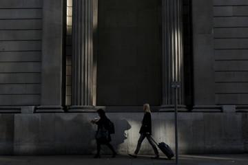 Pedestrians walk in the City of London