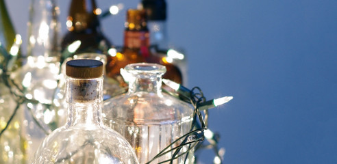 Vintage clear glass liquor bottles with Christmas lights