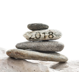 2018 written on a pebble pebbles stacked