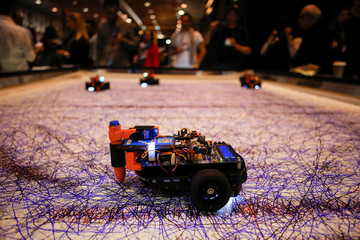 Robot drawing cars are seen during the Web Summit, Europe's biggest tech conference, in Lisbon
