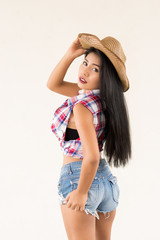 Portrait of asian sexy woman in cowgirl style pose for take a photo,Beauty and fashion concept