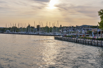 Sunset in harbor with yachts