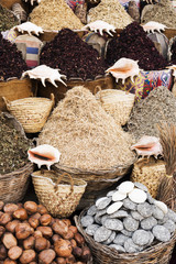 Condiment and ingredient concept. Dry herb hibiscus for tea in baskets. Hibiscus lilac flowers in baskets. Arabic herbs on traditional bazaar. Natural organic herbs.