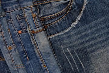 horisontal denim background, assortment of blue jeans, pile of blue jeans, denim textures