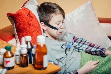 The boy makes inhalation breath