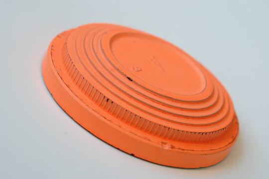 orange clay pigeon