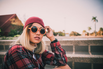 Portrait of asian hipster girl wear orange sunglass vintage style,lifestyle of single young woman,fashion indy style concept
