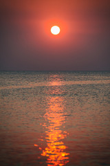 Sunset at the beach of Phu Quoc, sun disk beam