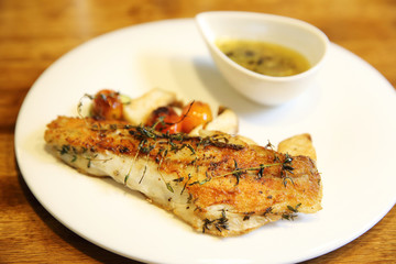 Sea bass fillet on wood background