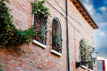 Italian facade of the window from the lattice