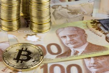A hundred dollar bills. Canadian dollars. Close up. Bitcoin. Digital Currency.