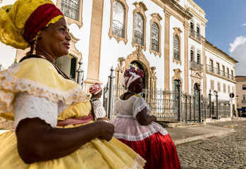 "Group of ""Baianas"" walking in the famous Pelourinho in Salvador, Bahia, Brazil"