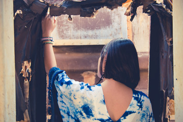 Close up asian beautiful girl in bohemian style vintage dark tone at trainstation