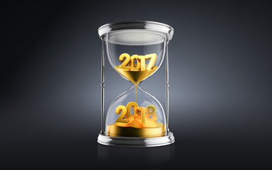 New Year 2018 concept with hourglass falling sand taking the shape of a 2018