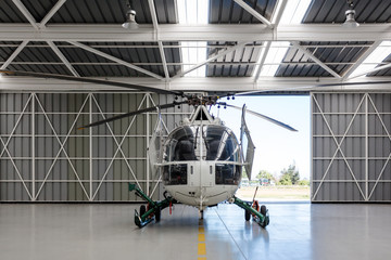 Foto op Plexiglas Helicopter Helicopter in the angar
