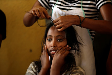Eritrean refugee gets her hair plaited in Hitsats refugee camp near Eritrean boarder, in Tigrai region