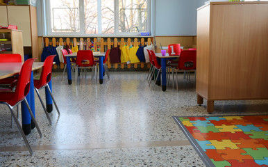 inside of a classroom in kindergarten with small chairs