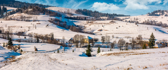panorama of Carpathian village in winter. beautiful rural scenery in mountainous area