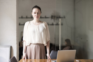 Portrait of mature businesswoman in office