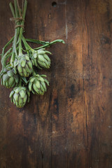 Artichoke bouquet in wooden background