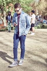 Teenage boy using smart phone in park