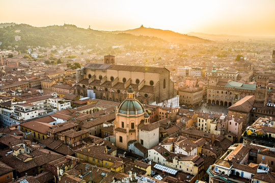 Aerial view of Bologna, Italy at sunset. Colorful sky over the historical city center and old buildings