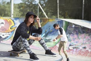 Teenage girl with popsicle at skatepark