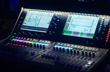 Board mixing console. Mixer. The sound engineer's console. Sound engineer's fingers are pressing the button audio controller.work place sound engineer's.