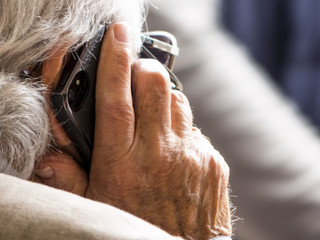 senior is talking on a mobile phone