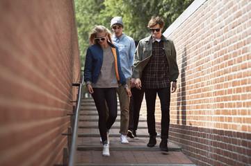 Teenage friends walking in alleyway