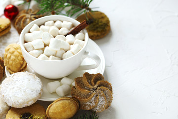 Cup of hot chocolate and assorted cookies: linzer cookies,shortbread, nuts cookie, orange almond cookie.