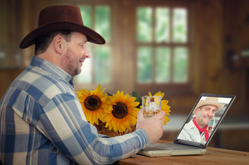Cowboy drinks whiskey with friend online