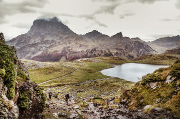 Mountain and lake beneath overcast sky
