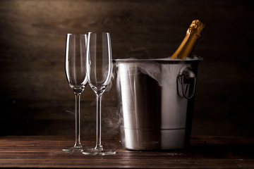Image of two empty wine glasses, iron bucket