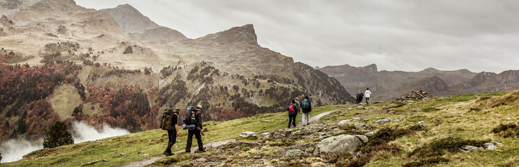 Group of hikers beside mountains