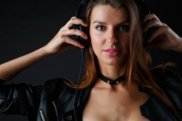 Photo of young girl in headphones with leather jacket
