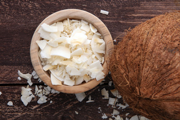 Coconut flakes with whole coconut. Tropical food concept.