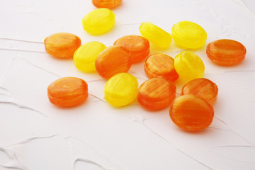 Mixed colorful fruit candies. bonbon in yellow and orange.