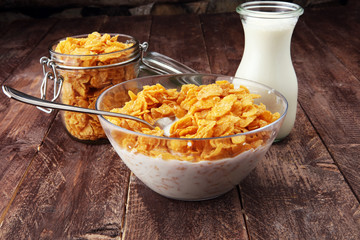 Cornflakes cereal and milk in a glass bowl. Morning breakfast concept