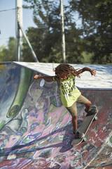 Boy skateboarding at skatepark