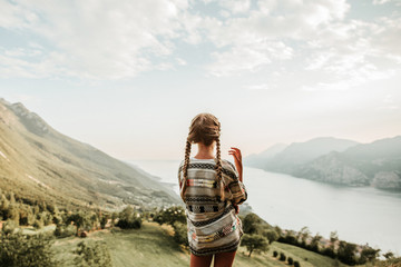 Rear view of girl on hill at Lake Garda, Italy