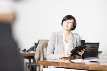 Businesswoman working with tablet PC in office