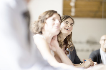 Young businesswoman smiling during meeting in conference room
