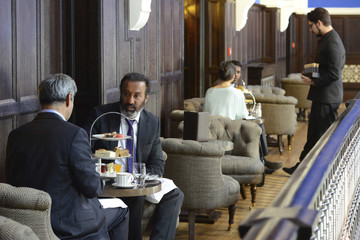 Businessmen talking with colleague at cafe