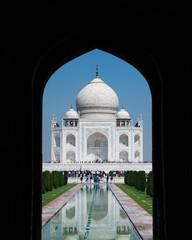 Taj Mahal through Arched Doorway Entrance In Agra, India